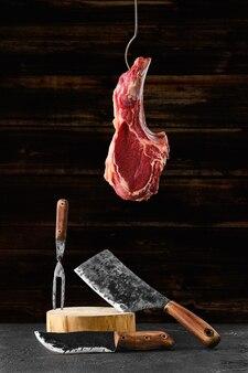 Beef ribeye steak on steel hook