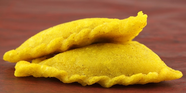 Beef samosa of southeast asia over brown surface