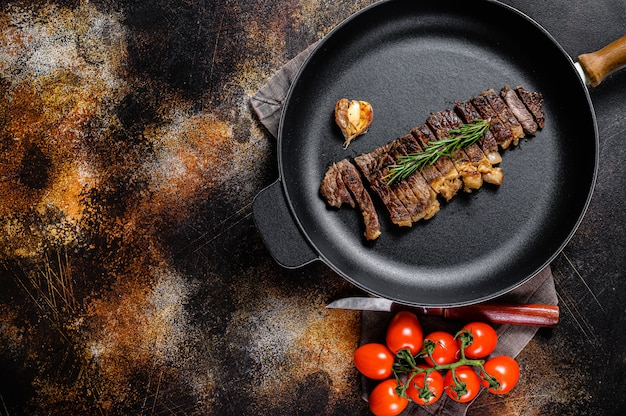 Beef sirloin steak in a frying pan.