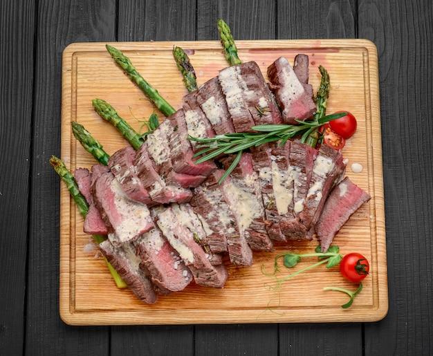 Beef sliced on wooden board