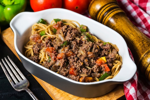 Beef spaghetti, there are plenty of tomatoes and chopped beef on it.