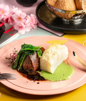 Beef steak served with sauces and herbs