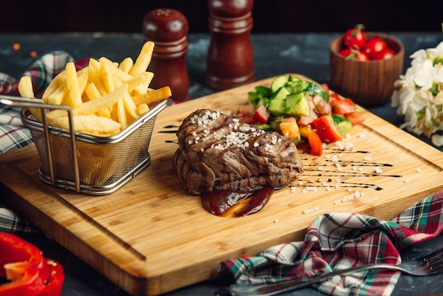 Beef steak with cherry tomato and french fries
