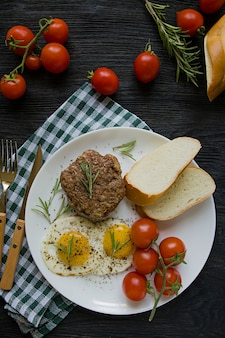 Beef steak with fried egg in spices.
