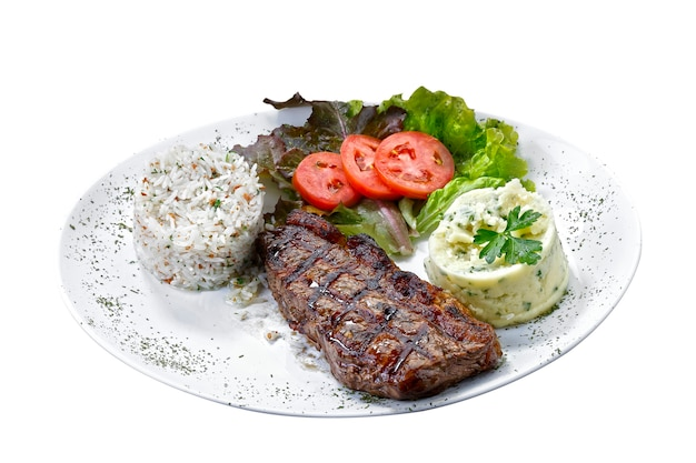 Beef steak with potatoes and rice in isolated white background