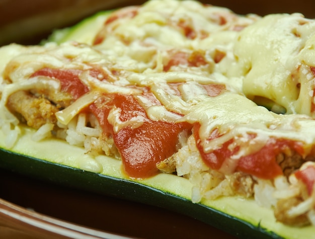 Beef stuffed zucchini boats  , zucchini halves are filled with ground chicken and provolone cheese, then topped with parmesan cheese