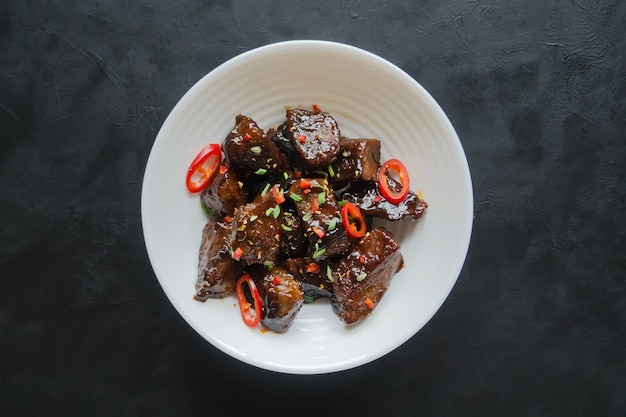 Beef with honey and black pepper sauce. top view.