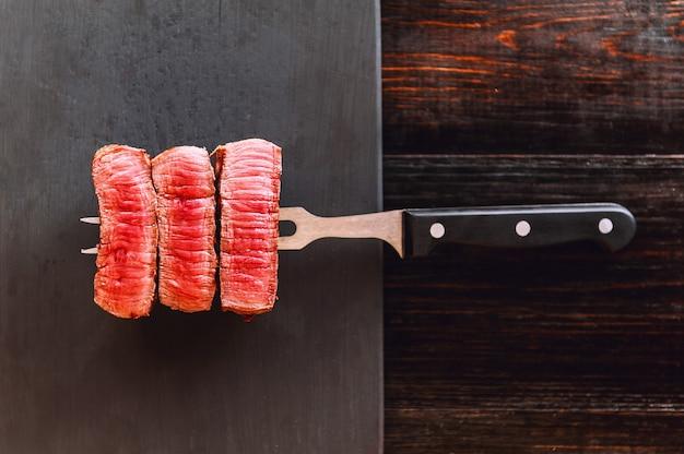 Beefsteak on cutting board