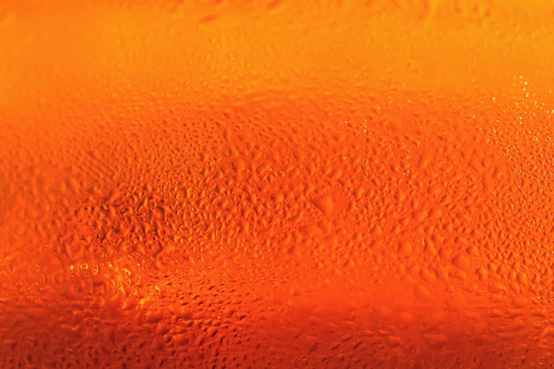 Beer. beautiful detail of beaten glass of beer with foam. abstract colorful background.
