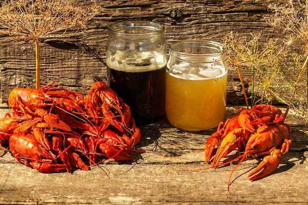 Beer boiled crayfish and dill on wooden background