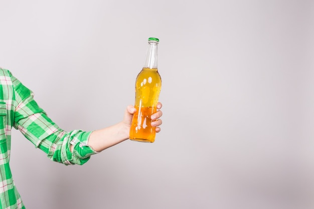 Beer bottle in the hand on white background.