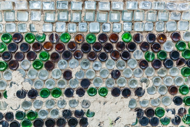 Beer bottles.the wall of colored beer bottles in cement.