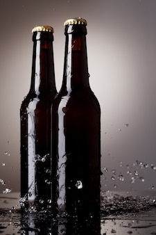 Beer bottles with water splash