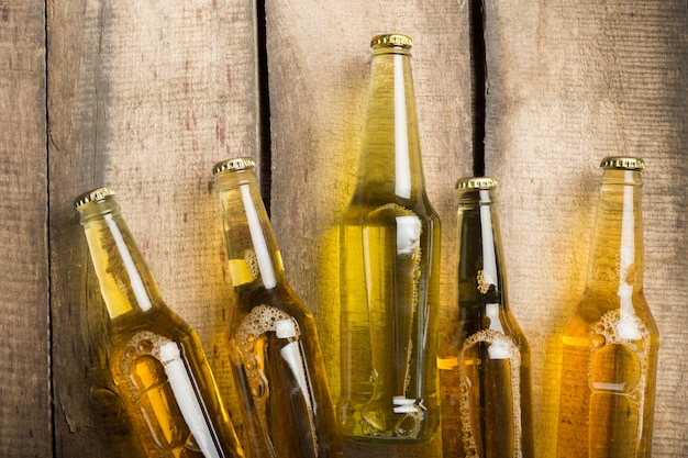 Beer bottles on a wooden table .