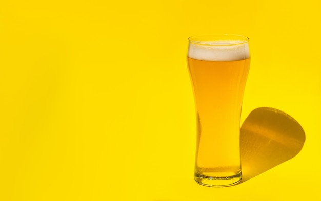 Beer. cold craft light beer in a glass with water drops. pint of beer. oktoberfest concept.