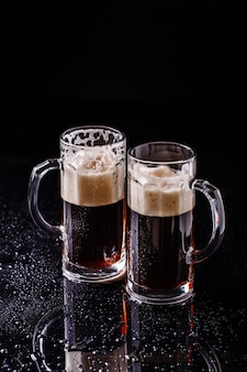 Beer on empty black table