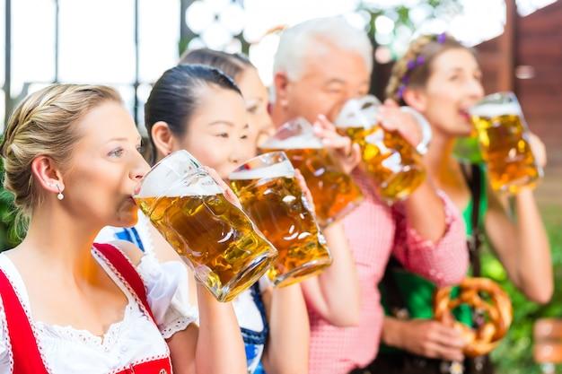 Beer garden - friends drinking in bavaria pub
