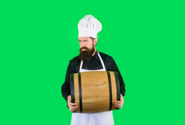 Beer in germany barman homemade beer wooden barrel of beer bearded cook with wooden barrel of