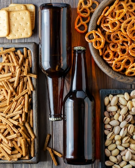 Beer in glass bottles and salty snacks for beer