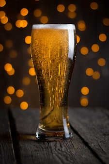 Beer in glass on dark table