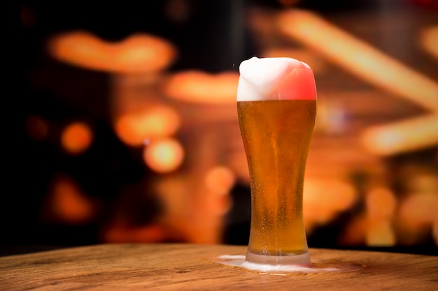 Beer glass in front of blurred background
