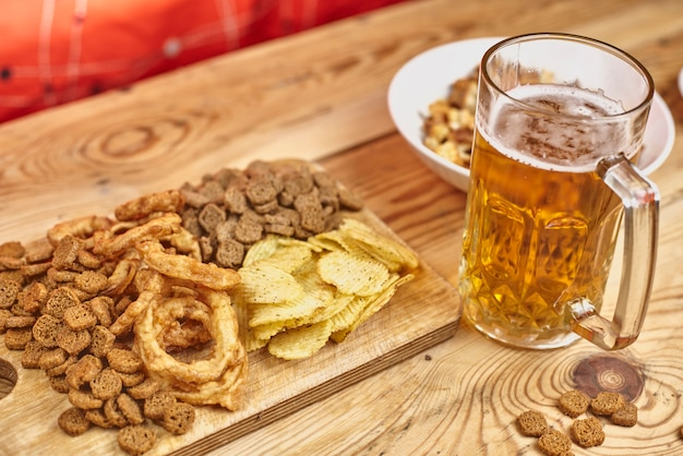 Beer glass and snacks