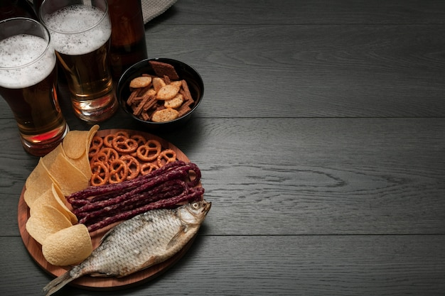 Beer glasses and platter of food with copy space