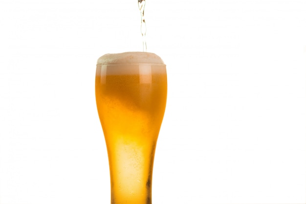 Beer is being poured into glass