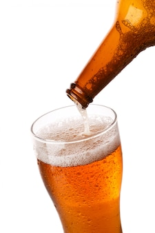 Beer is pouring into a glass