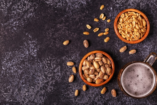 Beer and nuts on stone background
