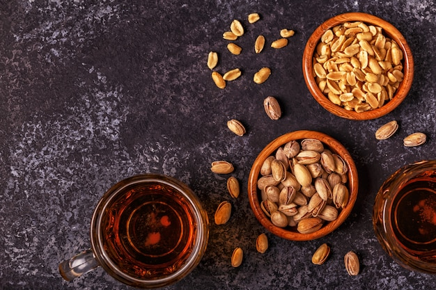 Beer and nuts on stone .