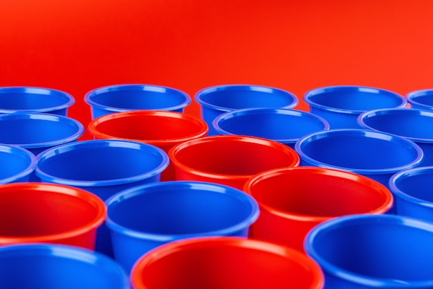 Beer pong, college party game. plastic red and blue color cups