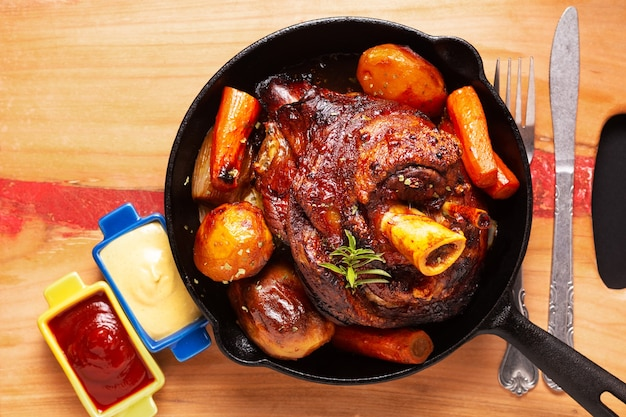Beer roasted crispy pork knuckle roasted in skillet iron pan