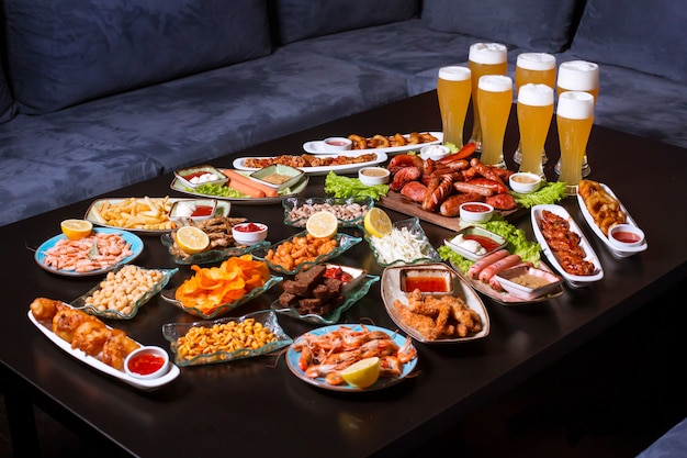 Beer set with various snacks and lots of beer