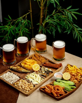 Beer setup with beer glasses and snack platters