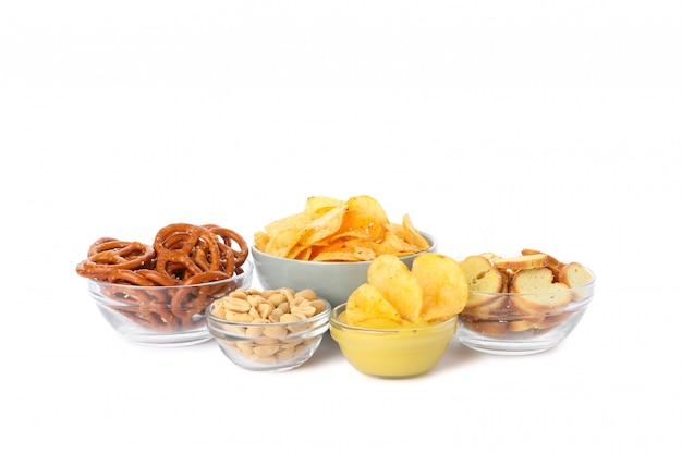 Beer snacks, potato crispy chips, nuts isolated on white, space for text