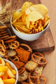 Beer snacks on stone and wooden . top view, copy space