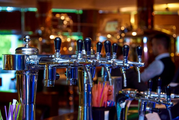 Beer tap on the bar in the restaurant.