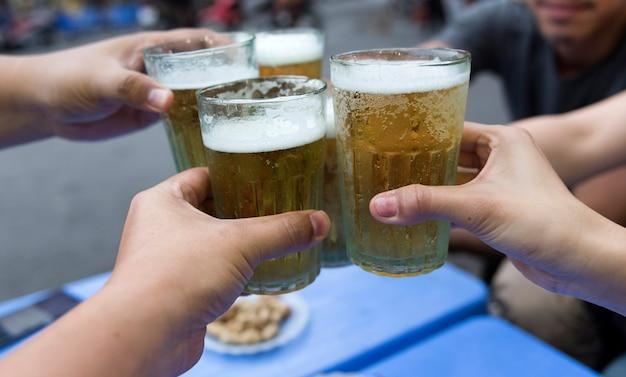 Beer toasting,street food vietnam