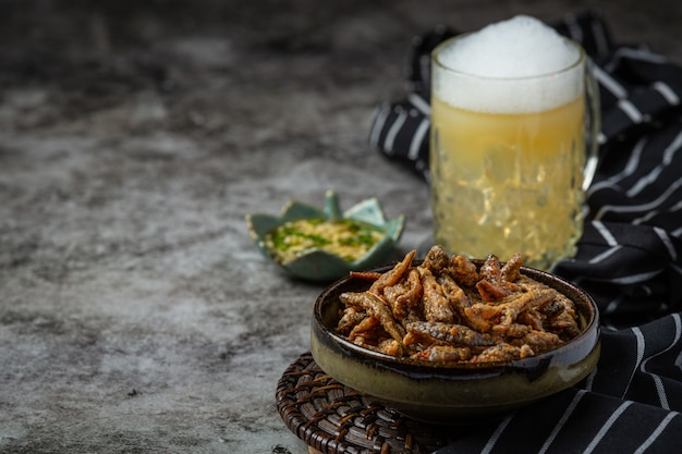 Beer with crispy fish hors d'oeuvres, world beer day.