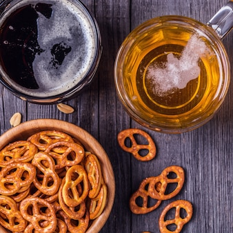 Beer with pretzels, crackers and nuts.