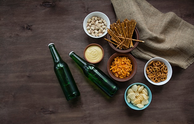 Beer with pretzels and various snacks