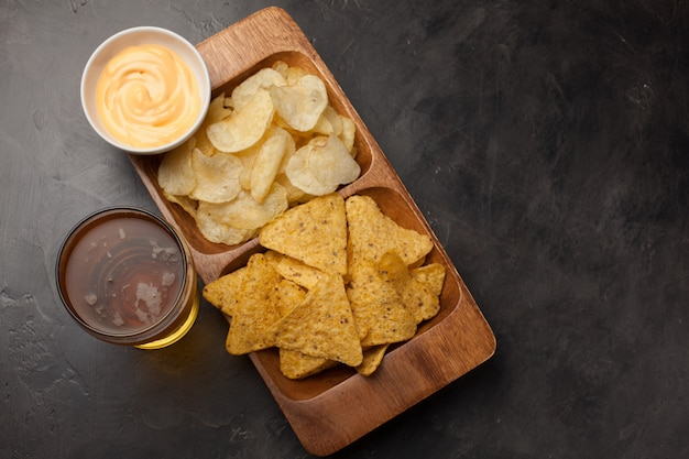 Beer with snacks are chips and nachos.
