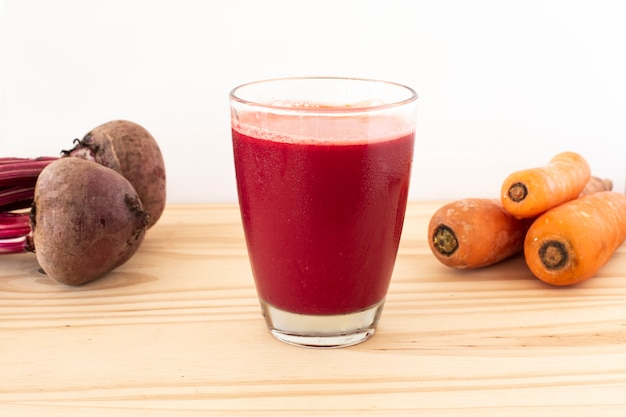 Beet juice with carrot with a white background