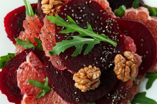 Beet salad with different ingredients, close up