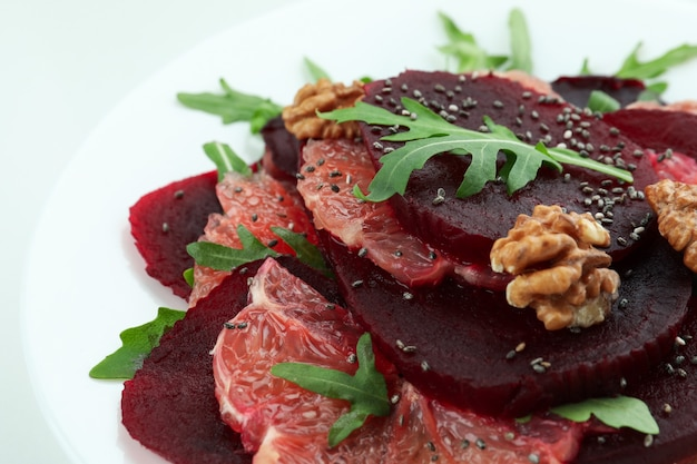 Beet salad with grapefruit on white, close up