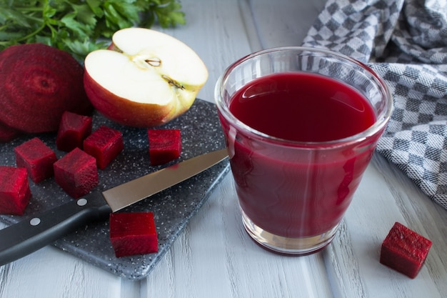 Beetroot and apple juice on the grey cutting board