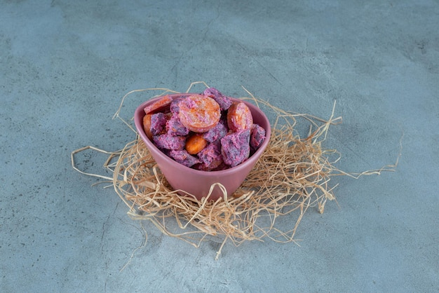 Beetroot and carrot salad in a ceramic cup.