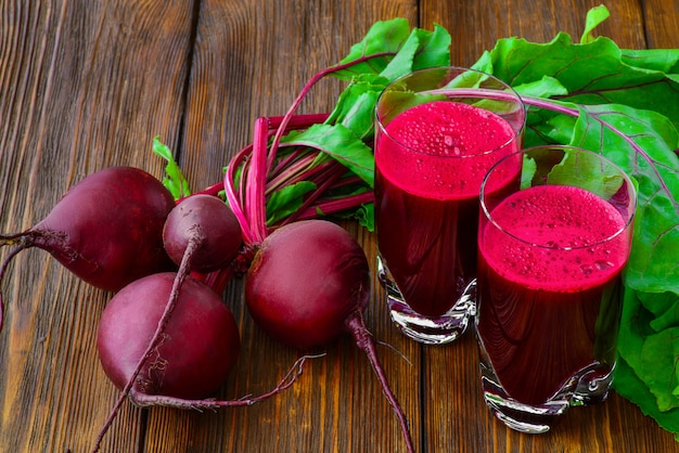 Beetroot juice in glass and fresh beetroot