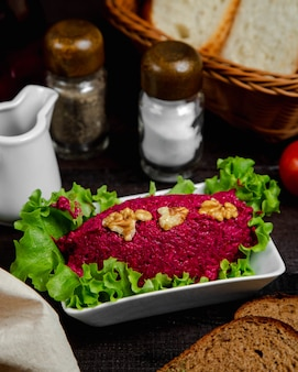 Beetroot salad topped with walnuts